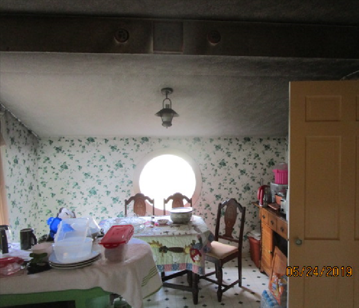 Picture of a sooty eat in area of the kitchen that was close to the fire