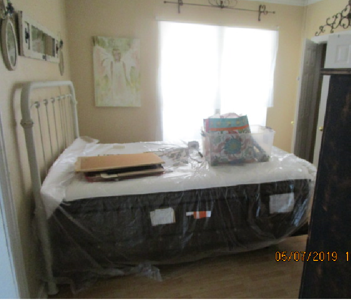 mattress and box spring covered with plastic
