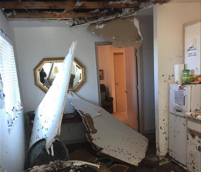 Larger sections of a drywall ceiling collapsed