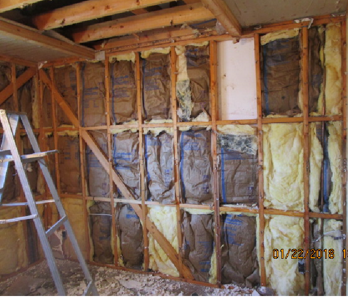 The site of a burst ceiling pipe after the drywall was removed